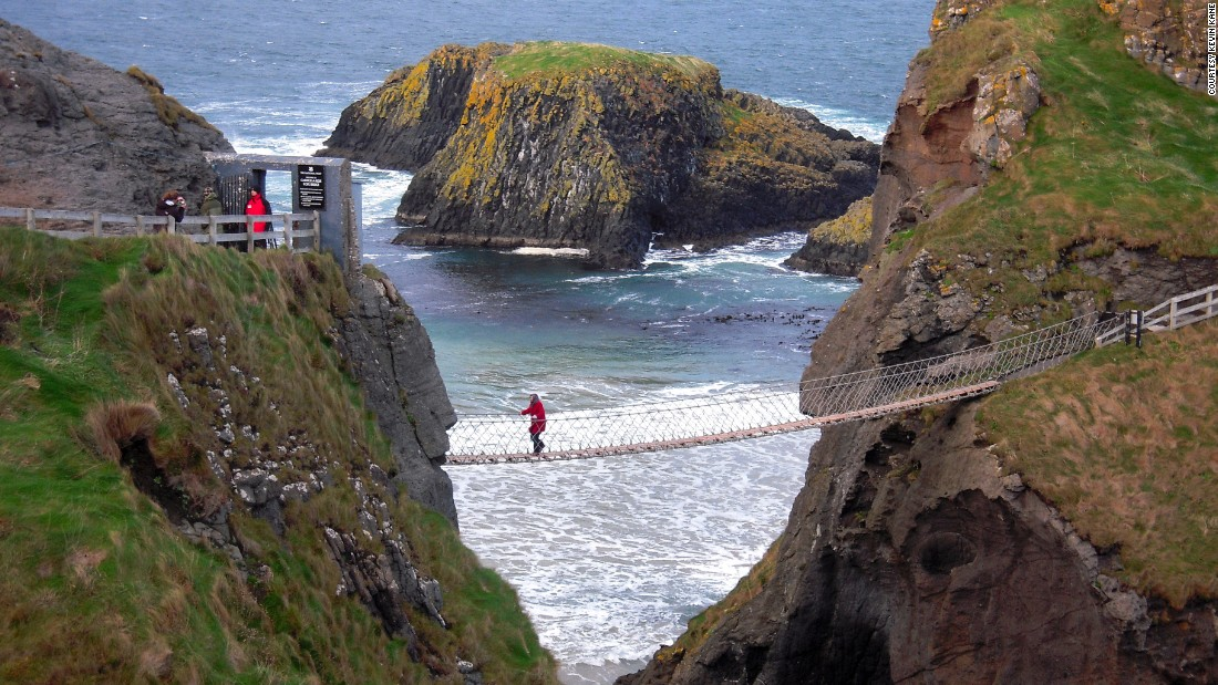 "CNN readers <a href=""http://ireport.cnn.com/topics/1100238"">share their best memories and photos</a> from mesmerizing visits to the Emerald Isle. Some of the island's most beautiful areas are in the north, repeat visitor <a href=""http://ireport.cnn.com/docs/DOC-1100483"">Kevin Kane</a> said. He shot this photo of Carrick-a-Rede Rope Bridge near Ballintoy on the Antrim Coast in Northern Ireland."