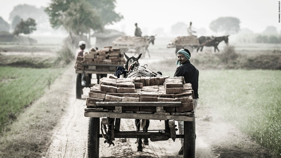 These images were part of a project by animal charity The Brooke -- here working mules and their drivers depart from a brick kiln close to Aligarh, an Indian city near Delhi.