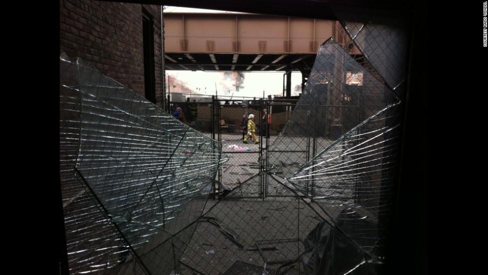 Broken glass and debris litter the area around the scene.
