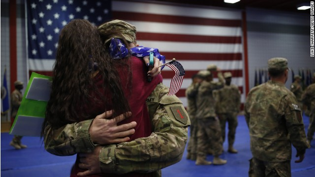 Family members embrace following a homecoming ceremony for members at Fort Knox, Kentucky last month after a nine-month combat deployment.