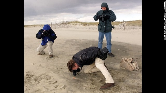 Journalists photograph possible EgyptAir Flight 990 debris in Nantucket, Massachusetts, in November 1999.