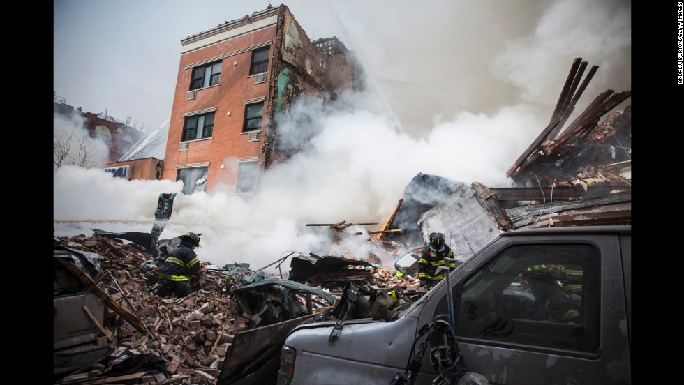 "New York City firefighters examine the rubble after <a href=""http://www.cnn.com/2014/03/12/us/gallery/harlem-explosion/index.html"">a massive explosion and fire</a> leveled two apartment buildings in the East Harlem neighborhood of Manhattan on Wednesday, March 12."