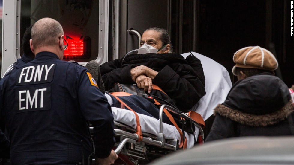 Medics put a person into an ambulance at the scene of the explosion on March 12.