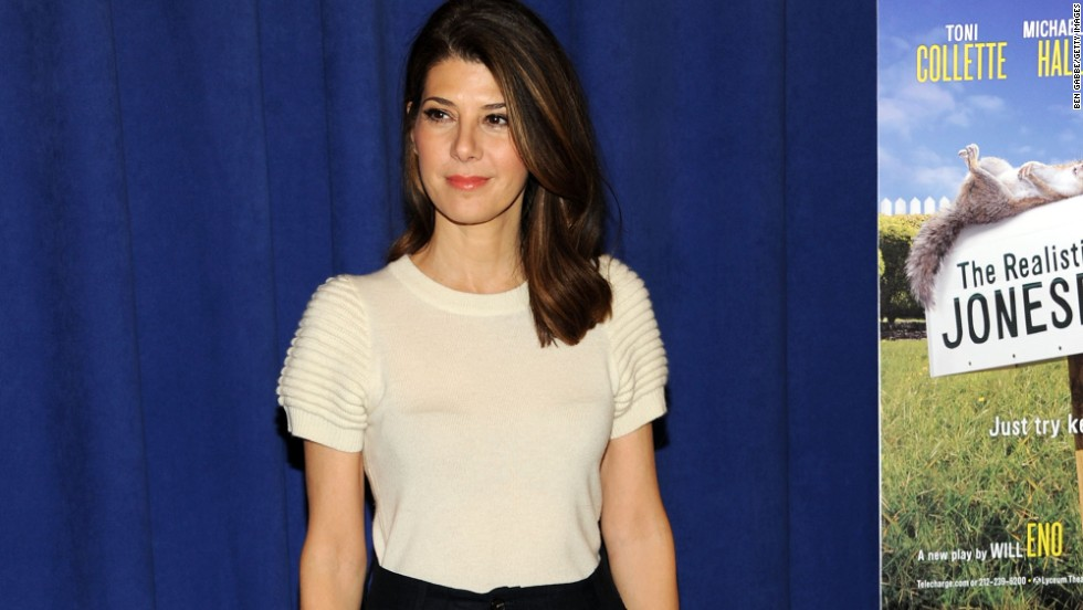 "Aunt May is not exactly a superhero -- but she's certainly super in the world of Peter Parker and ""Spider-Man."" Marisa Tomei plays the important role of Parker's adoptive mother in the new ""Spider-Man"" film."