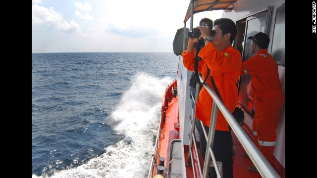 A member of Indonesian National Search and Rescue Agency scans the horizon of on the waters of the Strait of Malacca off Sumatra island, Indonesia, during a search operation for the missing Malaysia Airlines jet on Wednesday, March 12.