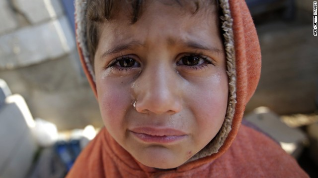 A Syrian child cries in the queue as families, who fled recent violence in the mountainous Qalamoun region, wait to be registered by the United Nations High Commissioner for Refugees (UNHCR) on November 19, 2013 in Arsal in the Lebanese Bekaa valley.