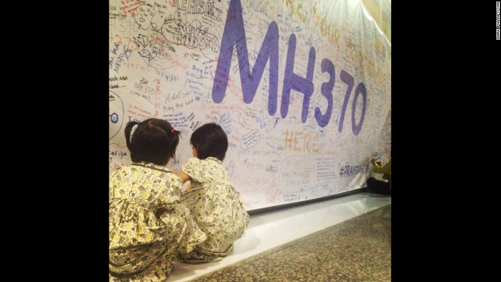 "Two young girls leave messages and well-wishes for those on board the missing Malaysia Airlines plane on the walls of Kuala Lumpur International Airport. By CNN's Mark Phillips, March 13.  Follow Mark on Instagram at <a href=""http://instagram.com/markpcnn"" target=""_blank"">instagram.com/markpcnn</a>."