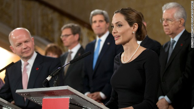 LONDON, ENGLAND - APRIL 11:  Actress Angelina Jolie (R) in her role as UN envoy, talks during  a news conference regarding sexual violence against women in conflict, as British Foreign Secretary William Hague and other G8 Ministers look on at the Foreign Ministers G8 meeting in Lancaster House on April 11, 2013 in London, England. G8 Foreign Ministers are holding a two day meeting where they will discuss the situation in the Middle East, including Syria and Iran, security and stability across North and West Africa, Democratic People's Republic of Korea and climate change. British Foreign Secretary William Hague will also highlight five key policy priorities.  (Photo by Alistair Grant  - WPA Pool/Getty Images)