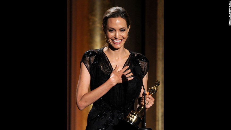 Jolie accepts the Jean Hersholt Humanitarian Award in November 2013, during the Academy of Motion Picture Arts and Sciences' Governors Awards ceremony.