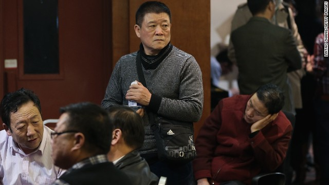 BEIJING, CHINA - MARCH 12: Chinese relatives of the passengers onboard Malaysia Airlines flight MH370 gather inside the relative area at Lido Hotel on March 12, 2014 in Beijing, China. Officials have expanded the searh area for missing Malaysia Airlines flight MH370 to include more of the Gulf of Thailand between Malaysia and Vietnam and land along the Malay Peninsula. The flight carrying 239 passengers from Kuala Lumpur to Thailand was reported missing on the morning of March 8 after the crew failed to check in as scheduled. Relatives of the missing passengers have been advised to prepare for the worst as authorities focus on two passengers on board travelling with stolen passports. (Photo by Lintao Zhang/Getty Images)