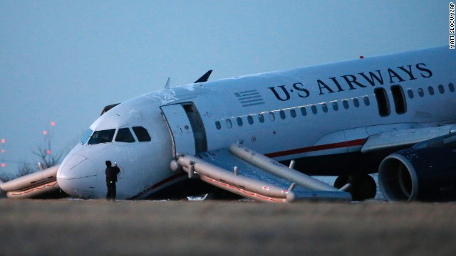 US Airways Flight 1702 sits at the end of a runway at the Philadelphia International Airport on Thursday.