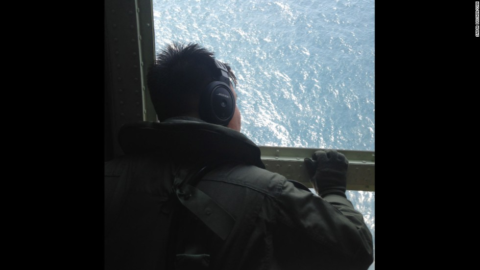 "The air crew looks out of a window during a search and rescue operation for the missing Malaysia Airlines plane over the Straits of Malacca.  Photo by CNN's Saima Mohsin, March 10.  Follow Saima on Instagram at <a href=""http://instagram.com/saimamohsincnn"" target=""_blank"">instagram.com/saimamohsincnn</a>."