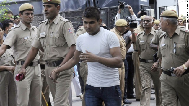 Vinay Sharma, one of the accused, is led into court in September 2013.