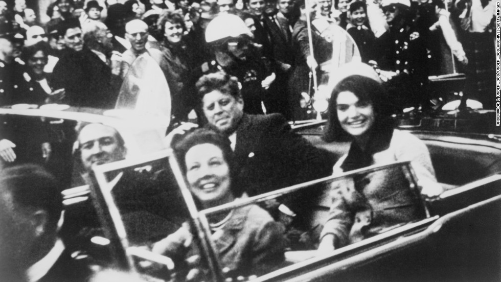 U.S. President John F. Kennedy sits with the first lady in the back of a limousine November 22, 1963, in Dallas. Kennedy's assassination remains one of the most shocking events of the 20th century, and it's one of its biggest mysteries. While a blue-ribbon panel concluded that there was only one gunman, a Gallup survey six decades later found that 60% of Americans don't believe that.
