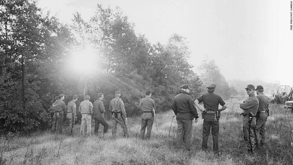 Police sweep a field in Waterford Township, Michigan, in search of Jimmy Hoffa's body in July 1975. The ex-Teamsters boss was last seen that month outside a Detroit-area restaurant. His disappearance is a mystery that triggers occasional digs by FBI agents looking for his remains.