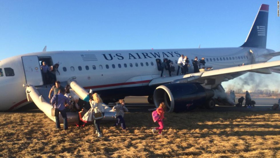 "Passengers evacuate US Airways Flight 1702 on Thursday, March 13, after <a href=""http://www.cnn.com/2014/03/13/us/philadelphia-airport-incident/index.html"">the jet's takeoff was aborted</a> in Philadelphia. A tire on the plane's front landing gear blew out. <a href=""http://www.cnn.com/2014/03/07/world/gallery/week-in-photos-0307/index.html"">See last week in 32 photos.</a>"