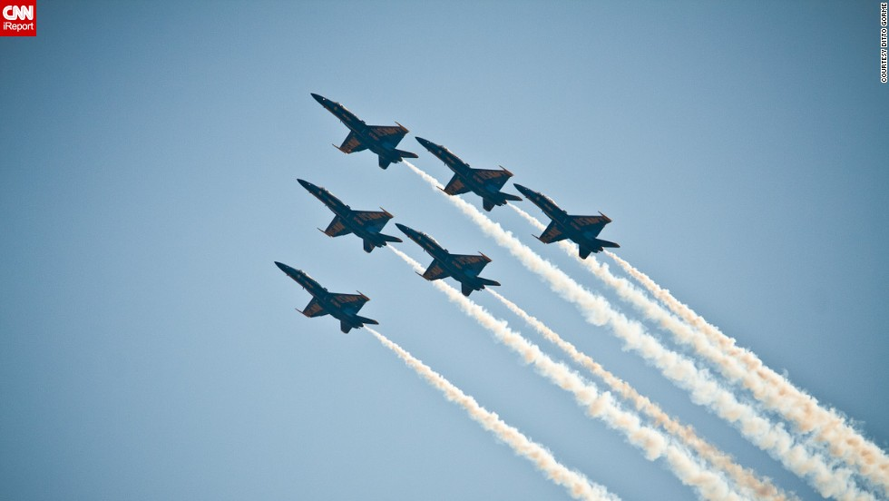 "A total of 16 officers voluntarily serve with the Blue Angels,<a href=""http://www.blueangels.navy.mil/team/"" target=""_blank""> according to its website</a>. Each team is composed of three tactical jet pilots, two support officers and one Marine Corps pilot."