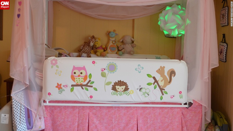 "Anabelle outgrew her crib this year, but still needed something to contain her and prop her in the right sleeping position, so the family got a hospital bed. ""It was so medical-looking and looked out of place in our home, so we dressed it up,"" Linzey said. Elyse designed the stickers."