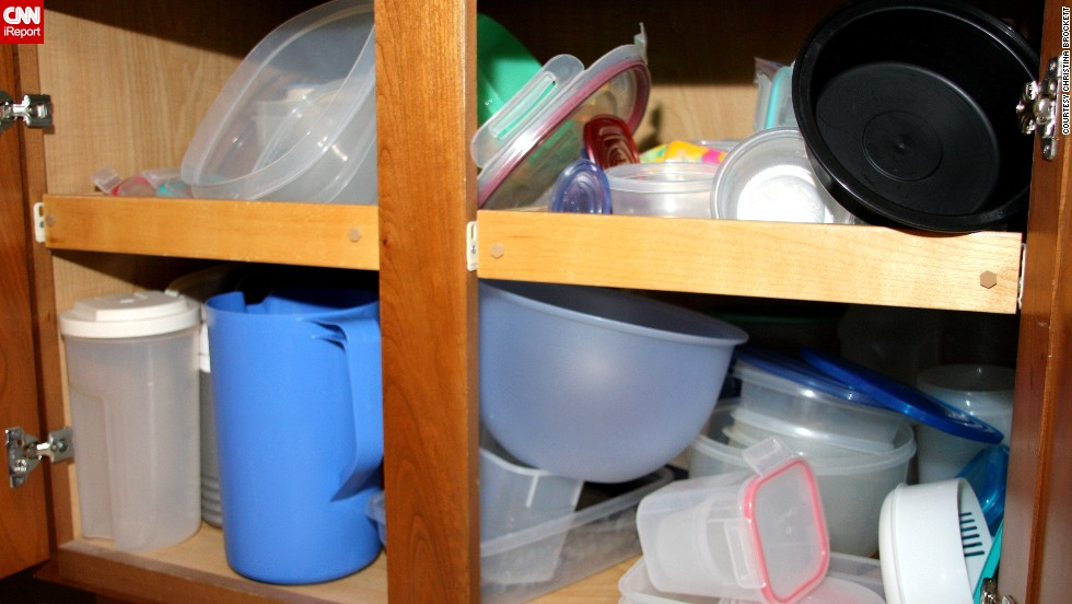"""Brockett's Tupperware cabinet: """"There is a reason that I have doors on my cabinets. You're safe unless you open them. With the doors closed I don't have to look at this mess. Unless, of course, I need to store something."""""""