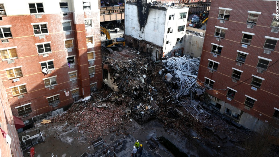 Rubble is seen on Friday, March 14, two days after an explosion leveled two apartment buildings in the East Harlem neighborhood of Manhattan, injuring dozens and killing at least eight people. Though authorities have said a gas leak may have triggered the explosion, Mayor Bill de Blasio told reporters Thursday that the official cause was under investigation.