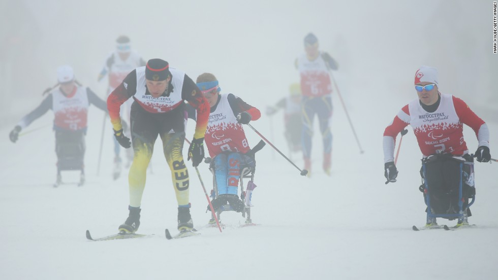 Tino Uhlig of Germany leads the field at the start of the 4 x 2.5-kilometer mixed relay cross-country on day eight of the Sochi 2014 Paralympic Winter Games.