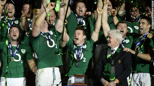 Brian O'Driscoll (front center) celebrates Ireland's Six Nations Champion ship success after winning at  the Stade de France.