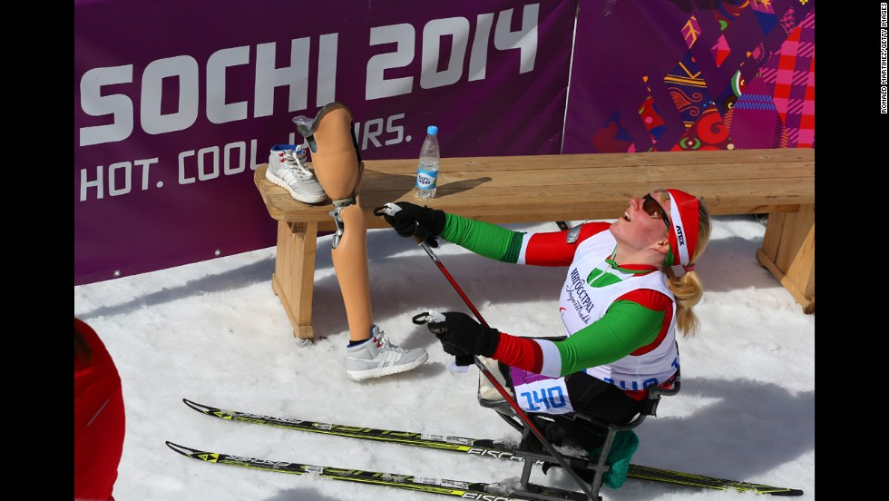 Valiantsina Shyts of Belarus reacts after crossing the finish line in the women's cross-country 5-kilometer sitting event on March 16.