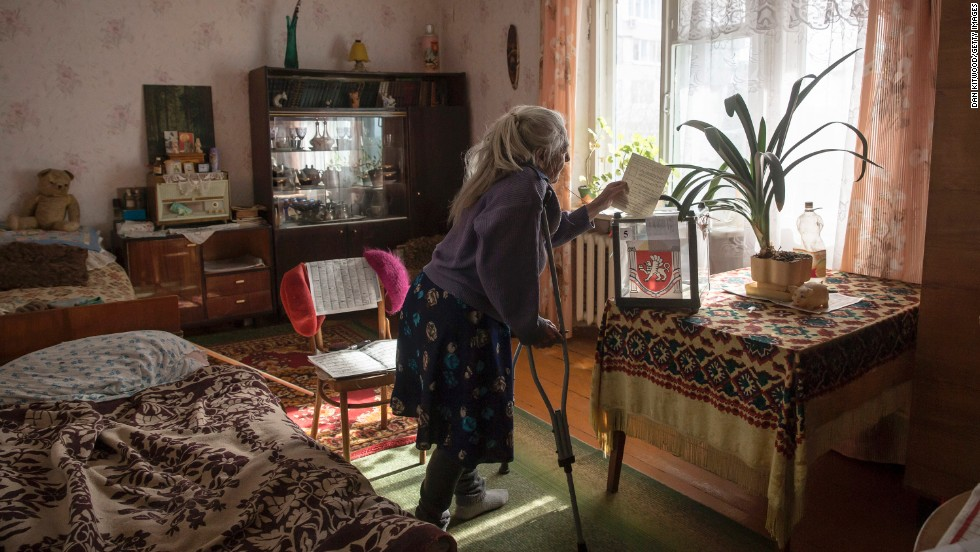 Solodkova Natalia, who was not healthy enough to visit a polling station, casts her vote at her home in Bakhchysaray, Ukraine, on March 16.