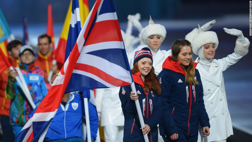 Flag bearer and Alpine skier Jade Etherington of Great Britain enters the stadium during Closing Ceremony.