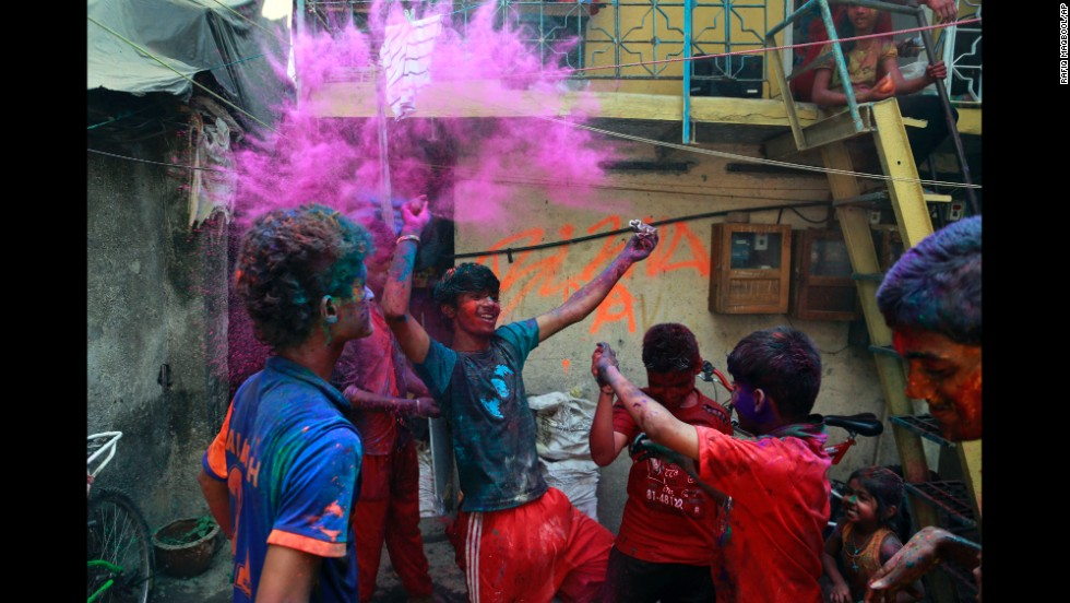 Children play with colored powder in Mumbai on March 17.