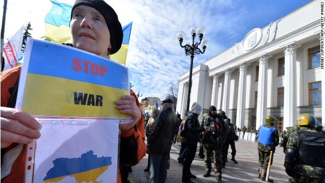 A woman holds a placard with an Ukraine's map reading 'Stop War' in front of the parliament in Kiev on March 17, 2014. Ukrainian troops will remain in Crimea, the country's defence minister said that day even as media reported the separatist peninsula planned to disband Ukrainian units there. The day before Crimeans voted overwhelmingly to join former political master Russia as tensions soared in the east of the splintered ex-Soviet nation amid the worst East-West crisis since the Cold War. AFP PHOTO/ SERGEI SUPINSKY (Photo credit should read SERGEI SUPINSKY/AFP/Getty Images)
