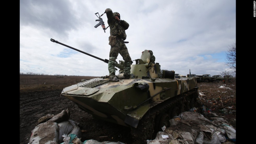 A Ukrainian soldier stands on top of an armored vehicle at a military camp near the village of Michurino, Ukraine, on March 17.