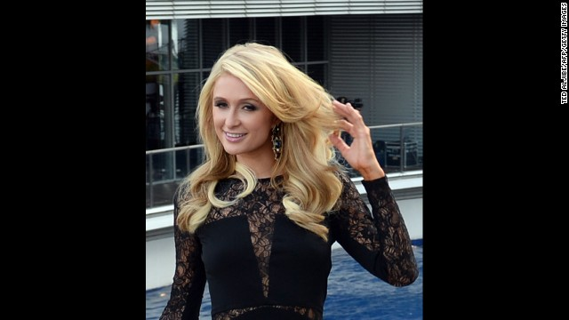 US socialite and entertainer Paris Hilton poses for photographers during the inauguration of her first real estate project, the Paris Beach Club, in Manila on March 13, 2014.