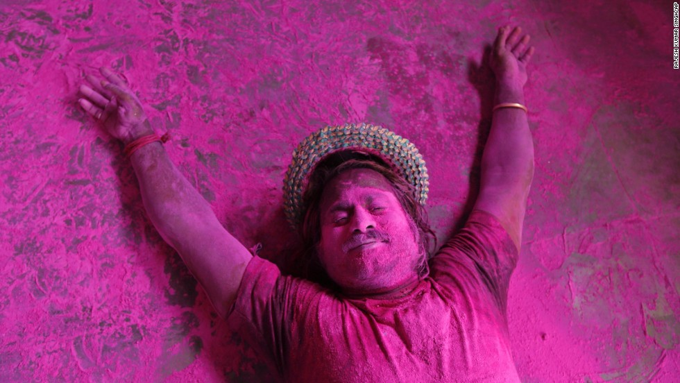 A man lies on the ground smeared in colored powder during Holi celebrations in Allahabad, India, on Monday, March 17. The Holi festival of colors is a Hindu celebration of the arrival of spring. It is celebrated mainly in India and Nepal.