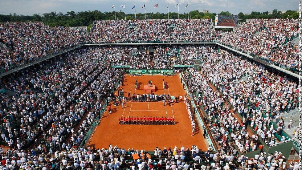 "Stade Roland Garros was built in 1928 to host France's maiden defense of the Davis Cup following the quartet's 1927 win. Each of the stadium's four main grandstands are named after one of them, while the winner of the French Open men's singles championship is presented with the ""Coupe des Mousquetaires"" trophy."