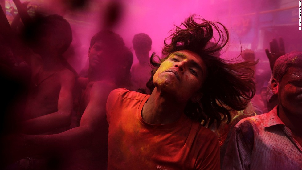 "MARCH 17 - GAUHATI, INDIA: With faces smeared with colored powder, Indians dance during celebrations marking <a href=""http://ireport.cnn.com/docs/DOC-1107646?ref=feeds%2Flatest"">Holi, the Hindu festival of colors.</a> The occasion also marks the advent of spring."