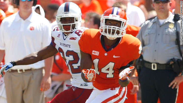 Clemson's Martin Jenkins, seen making an interception in a game last season, is a plaintiff in Monday's lawsuit.