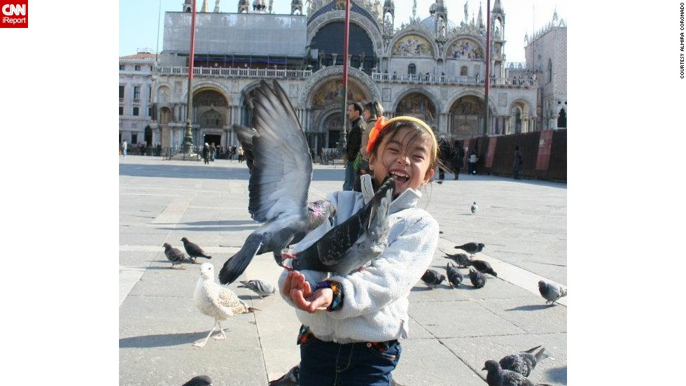 "CNN asked its readers to share their successes traveling with their children. <a href=""http://ireport.cnn.com/docs/DOC-1096138"">Almira Coronado</a> and her husband took their daughter, Michelle, to Italy when she was 5, where her most memorable moment was feeding the pigeons at Piazza San Marco in Venice. ""My husband and I really try to explain new things to Michelle so that she knows what to expect or at least has a better understanding of what's going on."""
