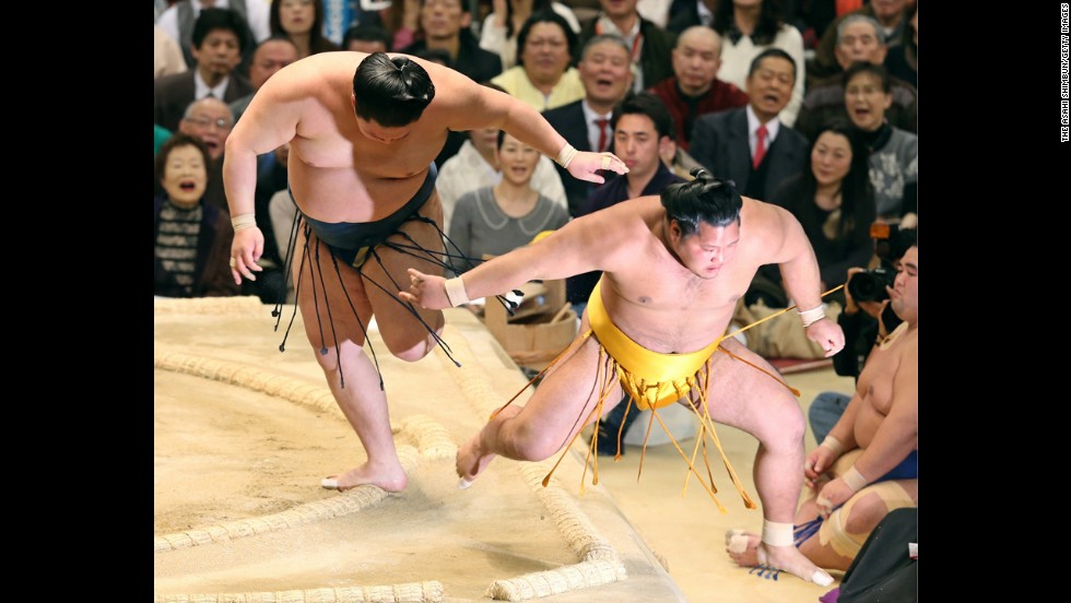 Goeido, left, pushes Shohozan out of the ring Wednesday, March 12, at the Grand Sumo Tournament in Osaka, Japan.