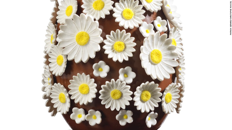 "Chocolatier <a href=""http://www.christophe-roussel.fr/"" target=""_blank"">Christophe Roussel</a> covered his chocolate egg with edible sugar daisies. You have to pick all of the flowers (she loves me, she loves me not...) to reach the grand cru Nyangbo 68% chocolate that lies beneath."