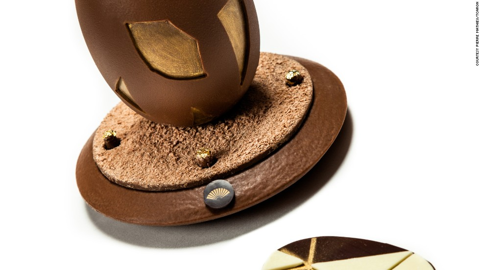 "<a href=""http://www.flickr.com/photos/illycaffe/8232448586/"" target=""_blank"">Pierre Mathieu</a>, the head pastry chef at the Mandarin Oriental Paris, crafted 50 of these magical eggs using milk chocolate, white chocolate, praline peanut and gold decoration. Each egg required 90 minutes of work. Inspired by a Chinese tanagram puzzle, the lucky foodie can use seven pieces of white chocolate to form a shape on the egg's base. According to Mathieu: ""This was a good way to combine the French knowledge we use to make chocolate with Mandarin Oriental's Asian heritage."" Each egg costs around $95."