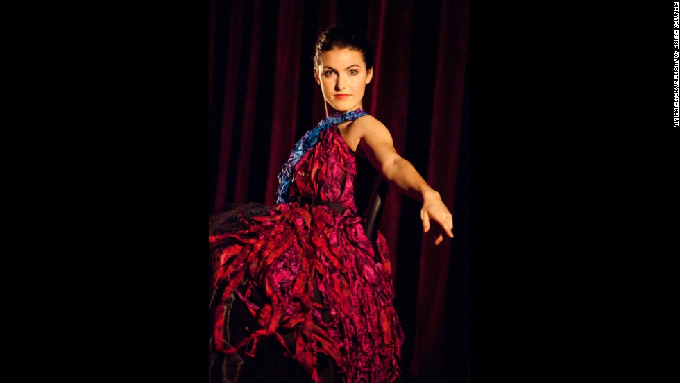 Eva Tavares, an opera undergraduate, models the evening gown embodiment of a brain tumor. The black faille halter dress is made from shredded blue and pink vintage silk saris applied to a full, floor-length skirt of sparkling organza, supported by a voluminous tulle underskirt.