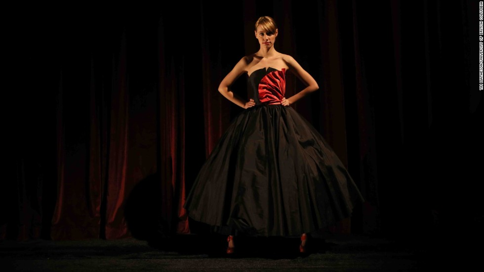 "Rebecca Burks, a University of British Columbia theater production and design undergraduate, models a black silk taffeta dress designed to look like an injured brain. ""There's an alternative to the pink ribbon, the yellow bracelet, the mustache -- we tend to have a branding relationship with fashion imagery and cancer,"" Firkins says of her project. ""It's like a bullet point -- terse and tight and almost cute. Finding something that isn't that language can generate conversation."""