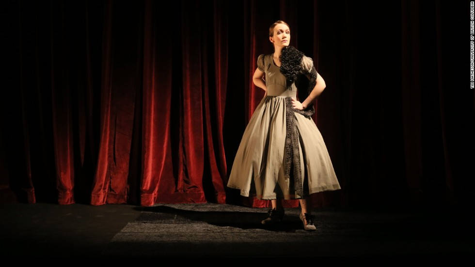 """Acting student Helena Fisher-Welsh wears a fashion version of a brain tumor -- a gray organza dress with black trim. Designer Firkins says this project has been a double journey for her. """"One is grappling with cancer and the stories of survival and struggle and resilience and the need for beauty when you're dealing with mortality,"""" she says, """"but at the same time discovering what art can do in relation with science."""""""