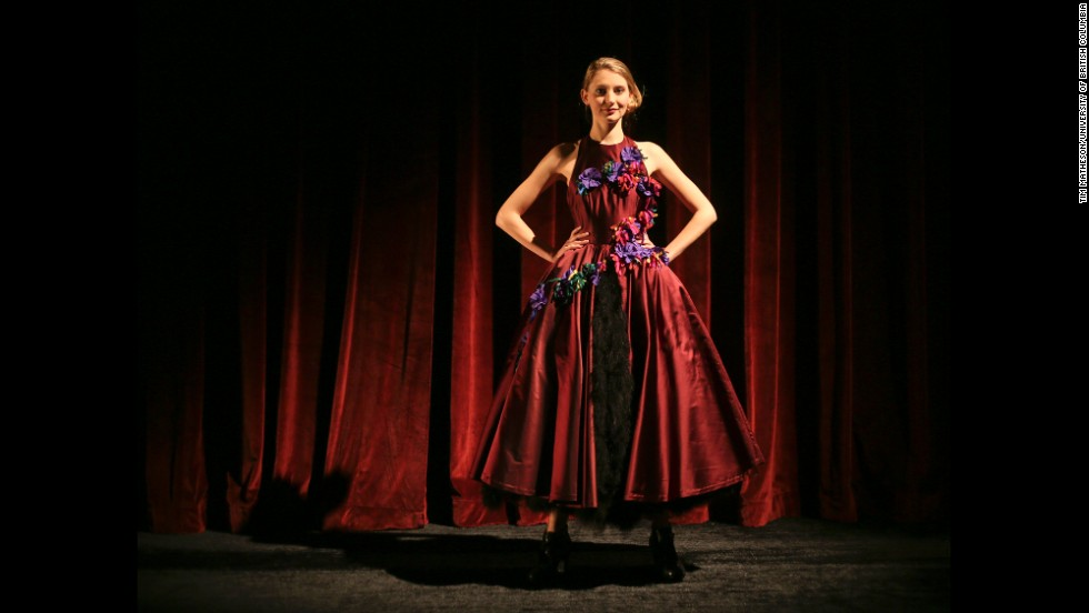Acting student Katherine McLaughlin models a satin halter dress with a feather underskirt, purple rosettes and shredded bias streamers that depict the cancerous interactions. Firkins says she first wanted to inspire dialogue about cancer, but she eventually hopes to auction the dresses and photos to raise money for research.