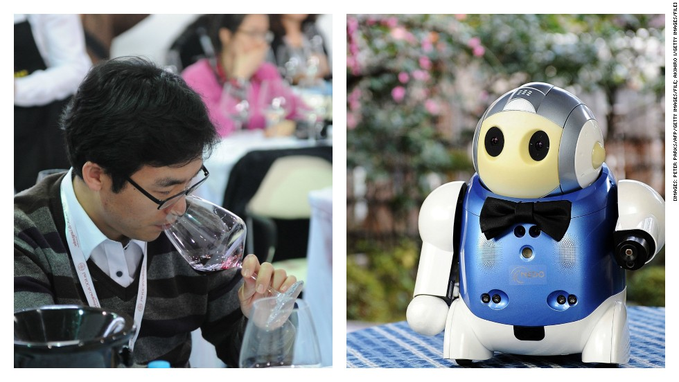 "<strong>ROUND THREE: WINE TASTING</strong><br /><br />Meet Japan's <a href=""http://news.bbc.co.uk/1/hi/technology/5312220.stm"" target=""_blank"">""Sommelier Robot,"" </a>the nifty know-it-all which can tell you the brand of wine you're drinking and what it tastes like --simply by pointing infrared rays at the liquid.<br /><br />Sure, its cute little bow tie is a nice touch. But can it regale you with drunken dinner party conversation long after your last guests have gone home? <br /><br />This one goes to humans.<br /><br /><em><strong>SCORE: Machine 2, Man 2</em></strong><br /><br />[Images: Peter Parks/AFP/Getty Images/File; Akihiro I/Getty Images/File]"
