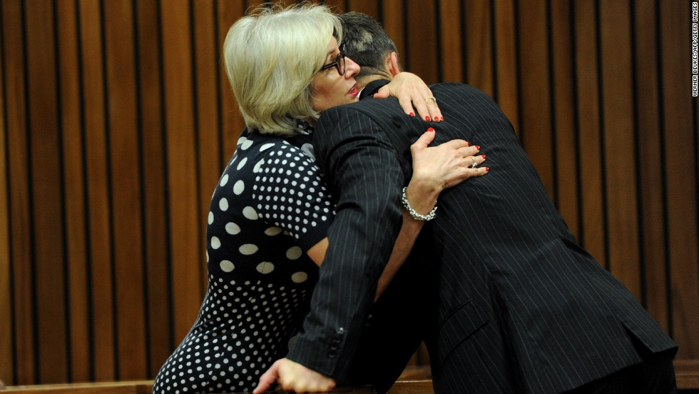Pistorius is hugged by his aunt Lois on March 18.
