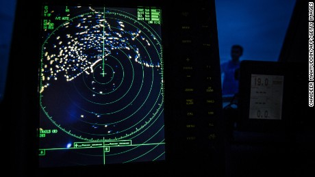 'We are committed': MH370 search area may double