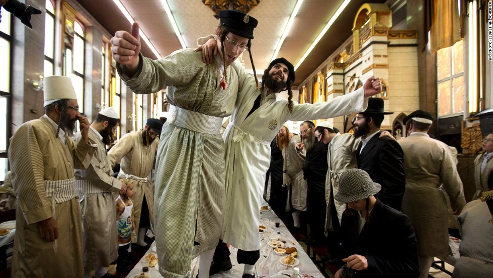 MARCH 18 - JERUSALEM: Ultra-Orthodox Jewish men in costumes dance at a yeshiva, a Jewish school, during Purim celebrations. The festival commemorates the rescue of Jews from genocide in ancient Persia, recorded in the book of Esther in the Bible.