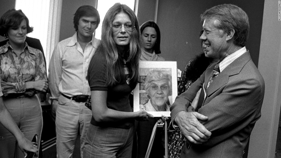 Steinem presents presidential nominee Jimmy Carter with a copy of Ms. magazine in 1976. The magazine featured Carter's mother on the cover.